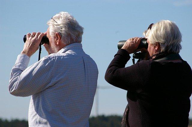 People looking through binoculars